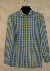 Fine high count cotton woven small-scale plaid shirt in shades of navy, olive green and grey.  Faux horn buttons. Long sleeves.