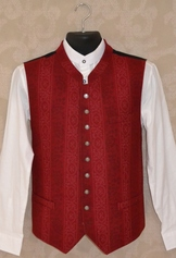 Wool vest with muted printed pattern in white and shades of taupe.  Small antique silver tone buttons with crest design. Inside chest pocket, and three slash pockets.