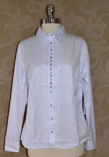 Ladies' white long sleeved blouse with front embroidery detail.