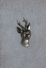 Pewter hat or lapel pin of small deer head, approximately 3/4 inch high.