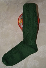 Green wool/poly blend knee socks for boys to wear with lederhosen.  Traditional cable stitch pattern on leg, with smooth fine gauge knitted foot.  Deep cuff allows for generous turn-down.
